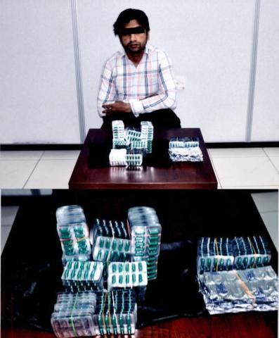 القبض على آسيوي يروج أقراص مخدرة