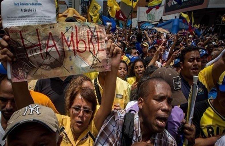 مئات الجوعى ينهبون المتاجر بفنزويلا