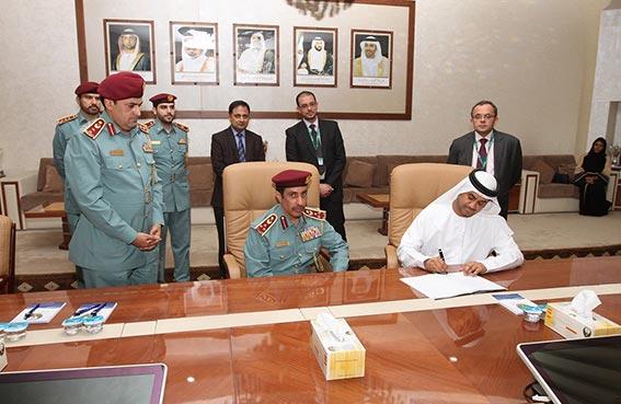 شرطة عجمان و بنك أبوظبي الوطني يوقعان اتفاقية تعاون