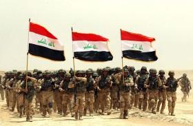 عناصر من داعش والحشد الشعبي في خندق واحد