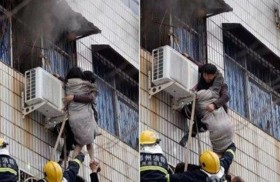 مشلول يتسلق مبنى لإنقاذ امرأة