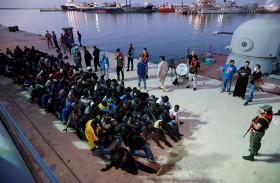 مهاجرون عادوا من ليبيا يتحدثون عن «جحيم مطلق»