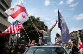 الحزب الحاكم في جورجيا يلبي مطالب المتظاهرين