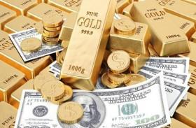 الذهب يتراجع 0.2 % مع ارتفاع الدولار