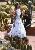 عارضة أزياء تستعرض أزياء للعلامة الأسترالية Nevenka في الحدائق النباتية الملكية خلال أسبوع الموضة في ملبورن. ا ف ب
