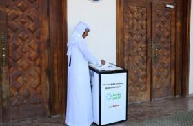 بلدية مدينة دبا الحصن تطلق مبادرة للحفاظ على الكتب المقدسة منتهية الصلاحية