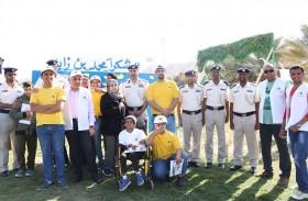 شرطة أبو ظبي تشارك في مخيم لـ أصحاب الهمم  بالعين