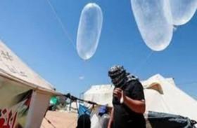 مجموعة فلسطينية تهدد بتكثيف إطلاق البالونات الحارقة من غزة