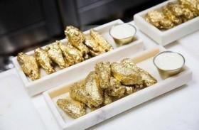 أجنحة دجاج مطلية بالذهب