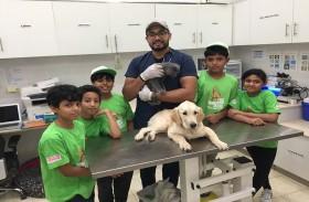 حديقة الإمارات للحيوانات تطلق برنامجاً لتعليم الأطفال  كيفية العناية بالحيوانات الأليفة