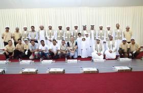 قطاع الفضاء الوطني يشارك في توزيع وجبات الإفطار على الصائمين بجامع الشيخ زايد الكبير