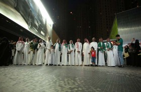 شرطة دبي تحتفي بمواليد اليوم الوطني السعودي
