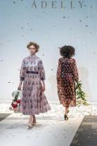 عارضتان تعرضان ابتكارات من ماركة الأزياء Adelly للمصمم ميكي كوماتسو لمجموعة خريف - شتاء 2021 في أسبوع الموضة في طوكيو - ا ف ب