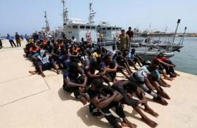 السراج يرفض فكرة إقامة مراكز للمهاجرين في ليبيا