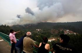 عشرات القتلى والجرحى في حريق غابات بالبرتغال